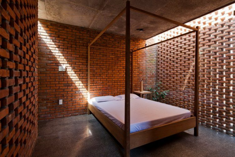 Concrete Bedroom With Brick Wall Accent